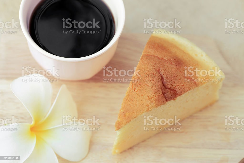 Pieces of Japanese style Cheesecake and cup of black coffee. stock photo
