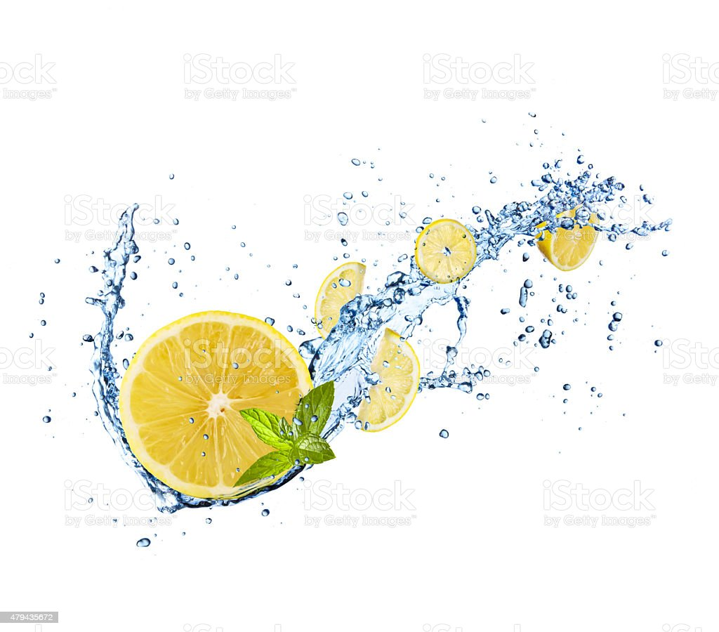 Pieces of lemons in water splash on white stock photo