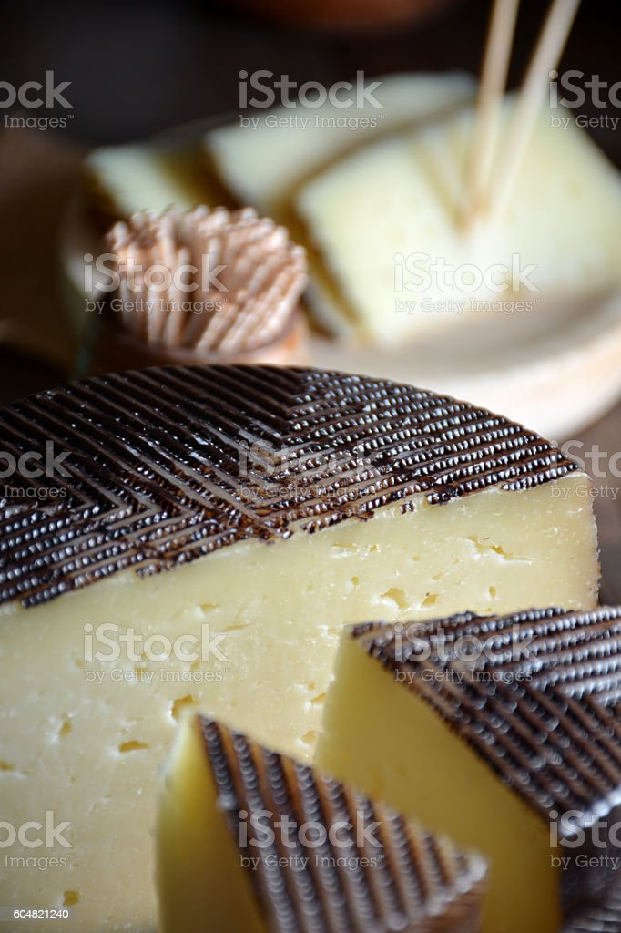 Pieces of manchego cheese cured stock photo