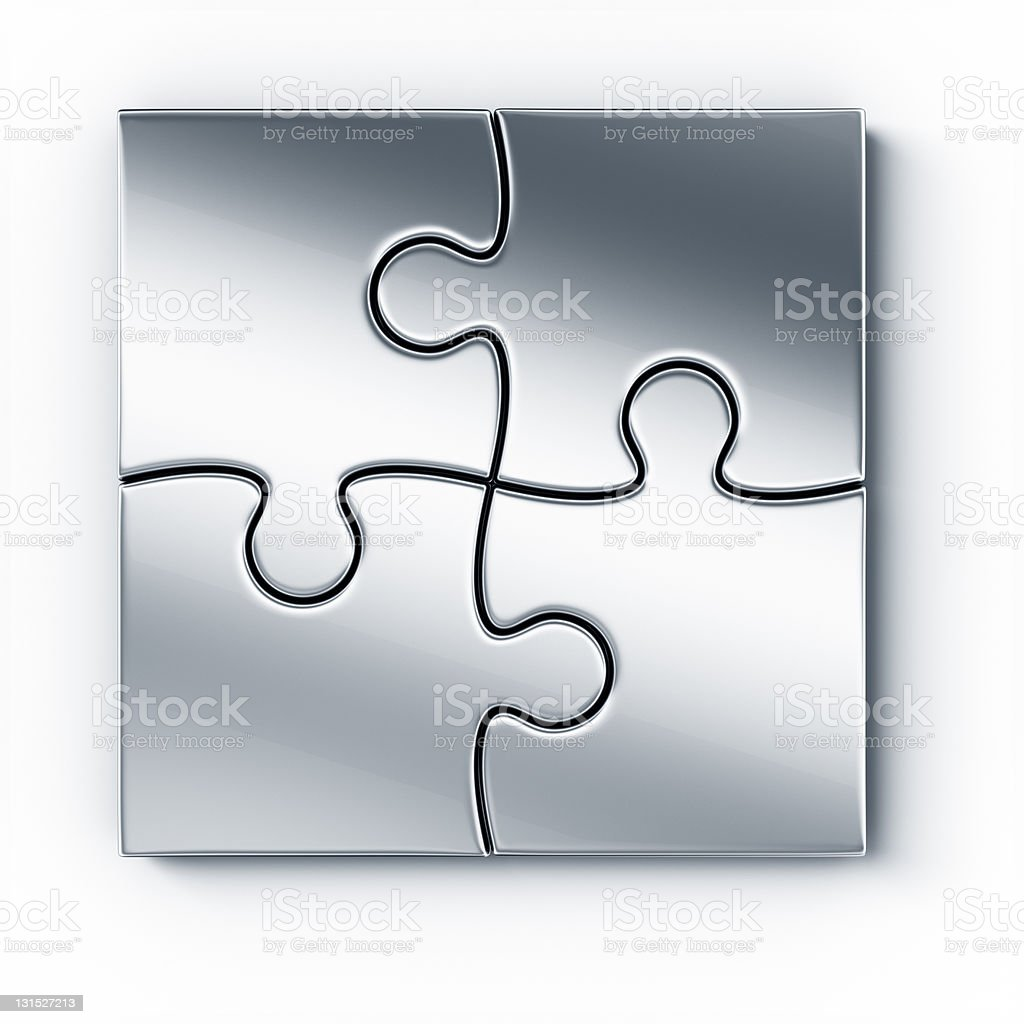 4 pieces of metal puzzle pieces that fit together perfectly stock photo