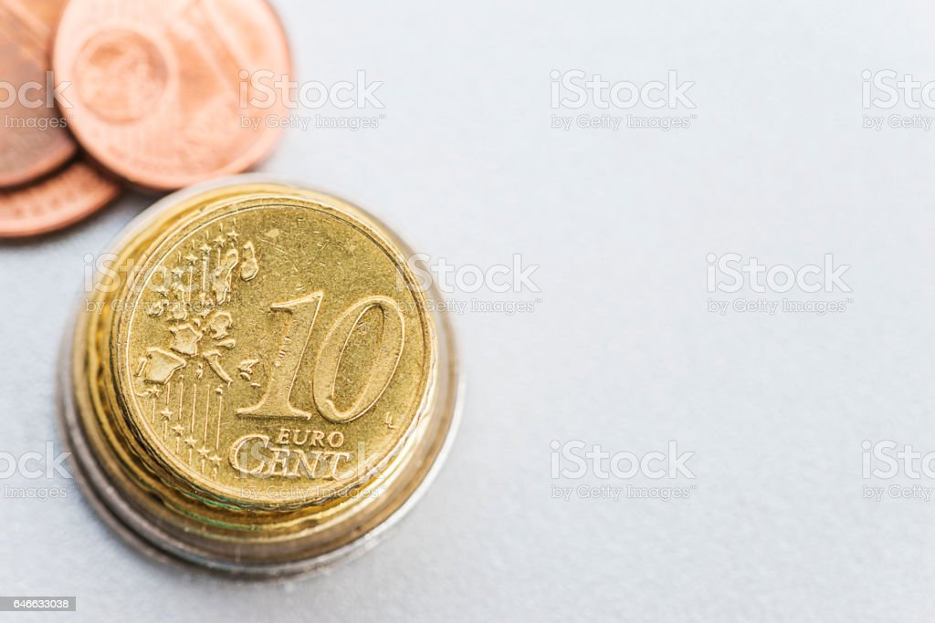 pieces of money on a light background stock photo