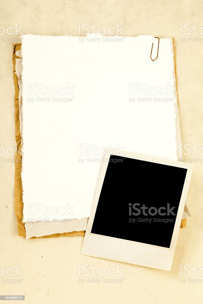 Pieces of old paper and a blank photo frame. royalty-free stock photo