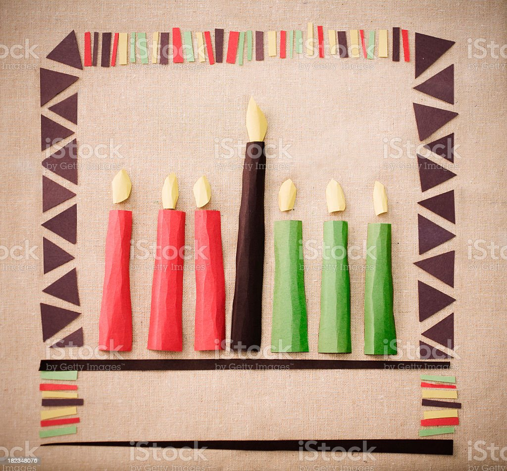 Pieces of paper cut out and placed on paper to make candles royalty-free stock photo