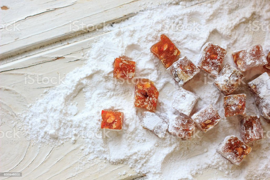 Pieces of quince jam in sugar powder. stock photo