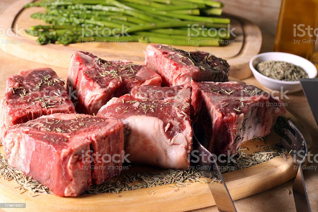 Pieces of raw meat on a wooden board royalty-free stock photo