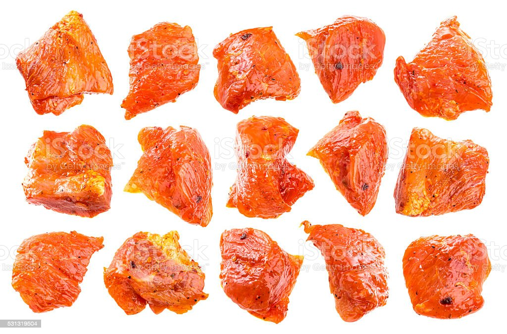 Pieces of raw pork isolated on white background. stock photo
