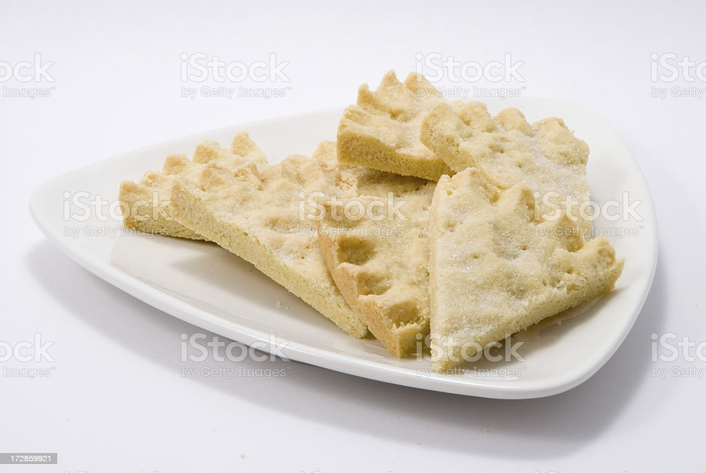 pieces of shortbread on a white triangular plate royalty-free stock photo