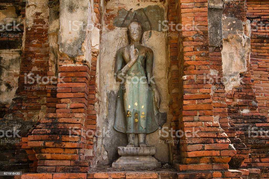 pieces of stones antique buddha and antique brick wall stock photo