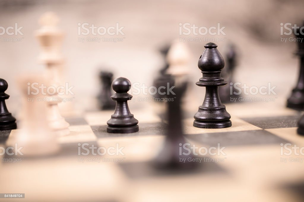 Pieces on chess game board.  Strategy concept. stock photo