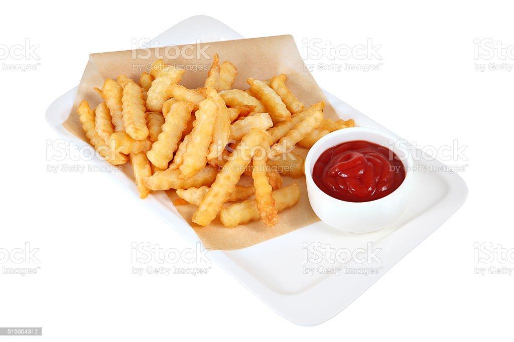 Pieces potato fri with bowl of tomato sauce,  studio shot. stock photo
