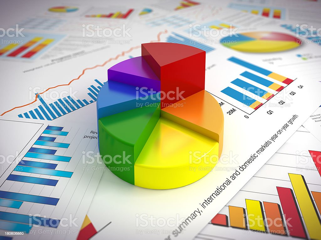 Pie-chart on paper graphs stock photo