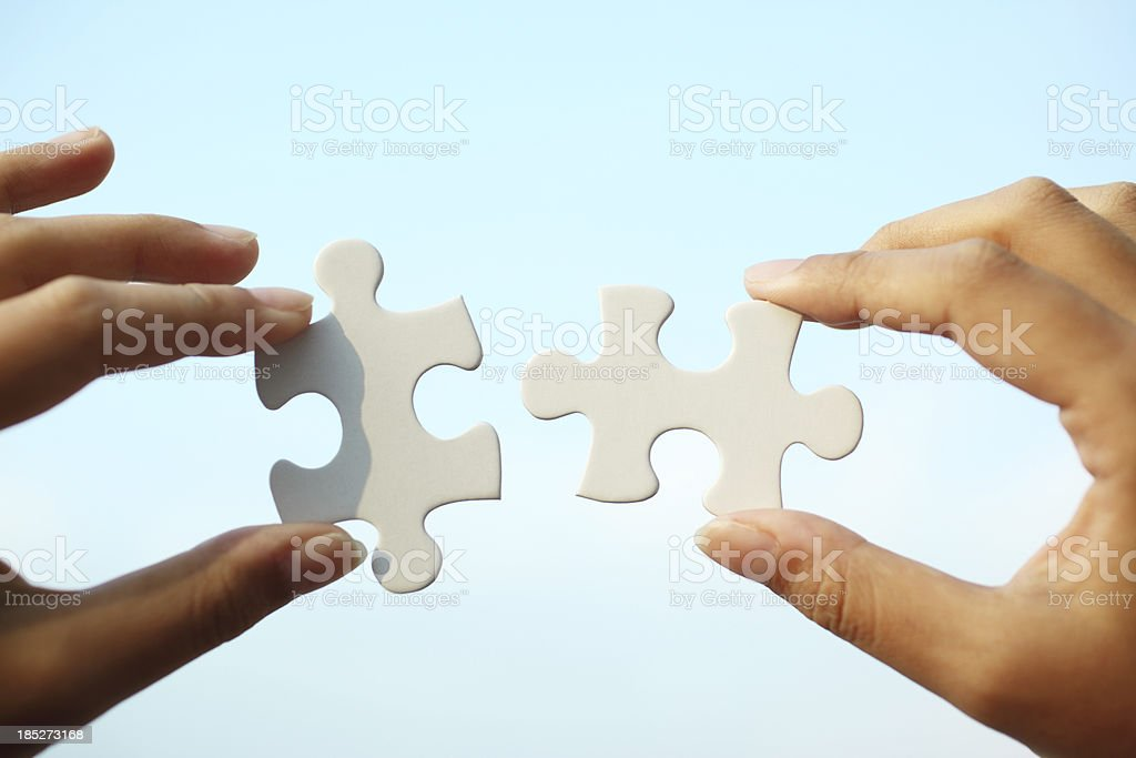 Piecing Together Puzzle stock photo