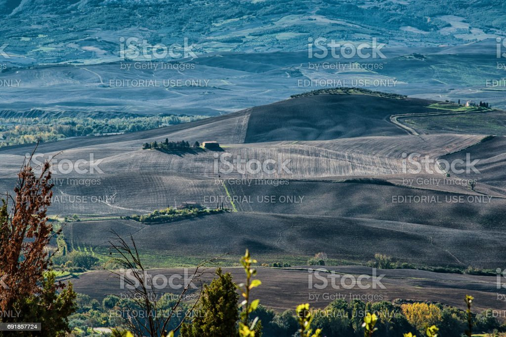 Pienza - Tuscany/Italy, October 30, 2016: Scenic Tuscany landscape with rolling hills and valleys in autumn, near Pienza - Val D'Orcia, Italy stock photo