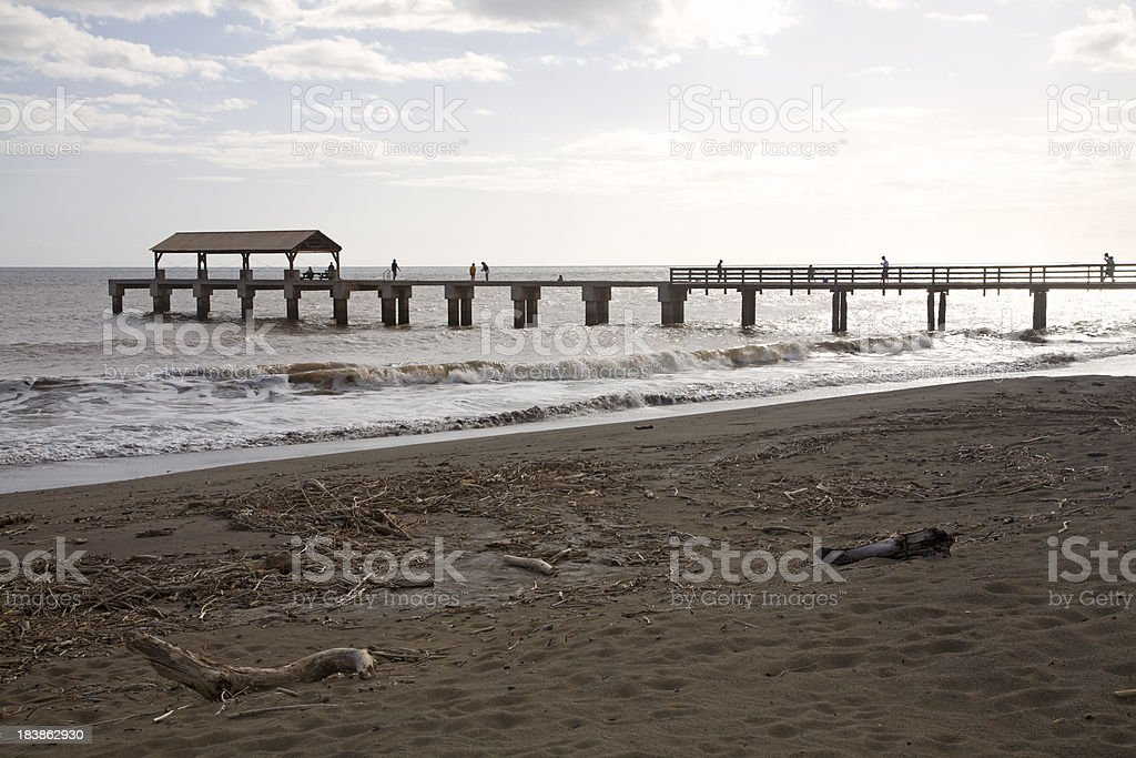 Pier And Beach Waimea Town Kauai At Dusk. stock photo