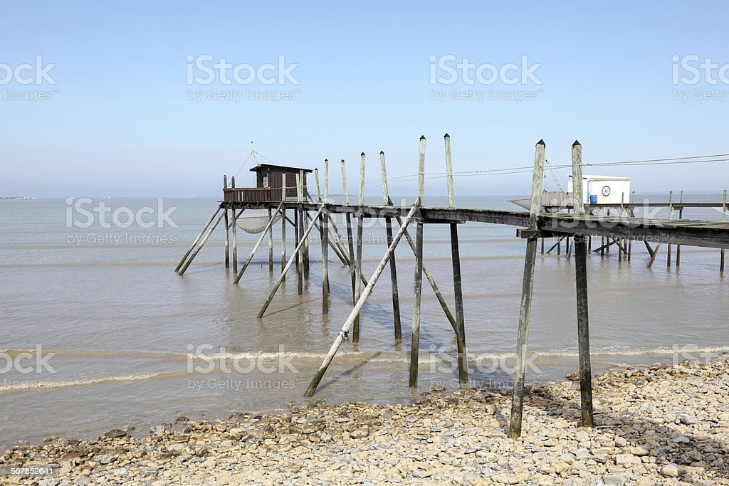 Pier and cabins for fishing in the atlantic ocean stock photo