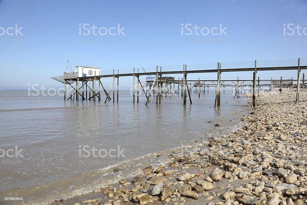 Pier and cabins for fishing stock photo