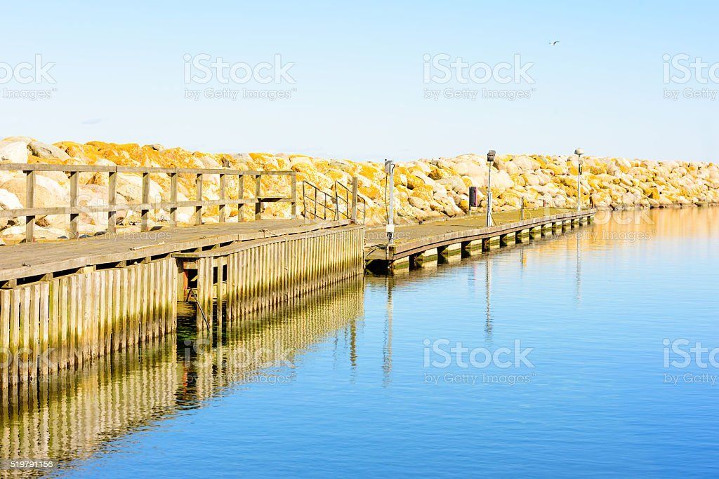 Pier and calm water stock photo
