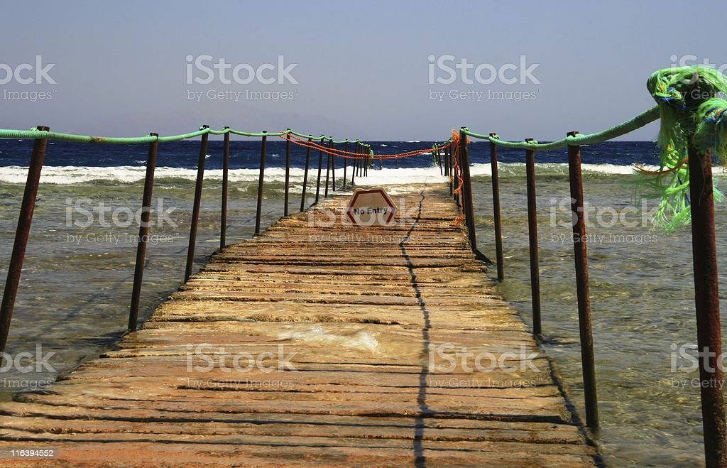 Pier and coral reef stock photo