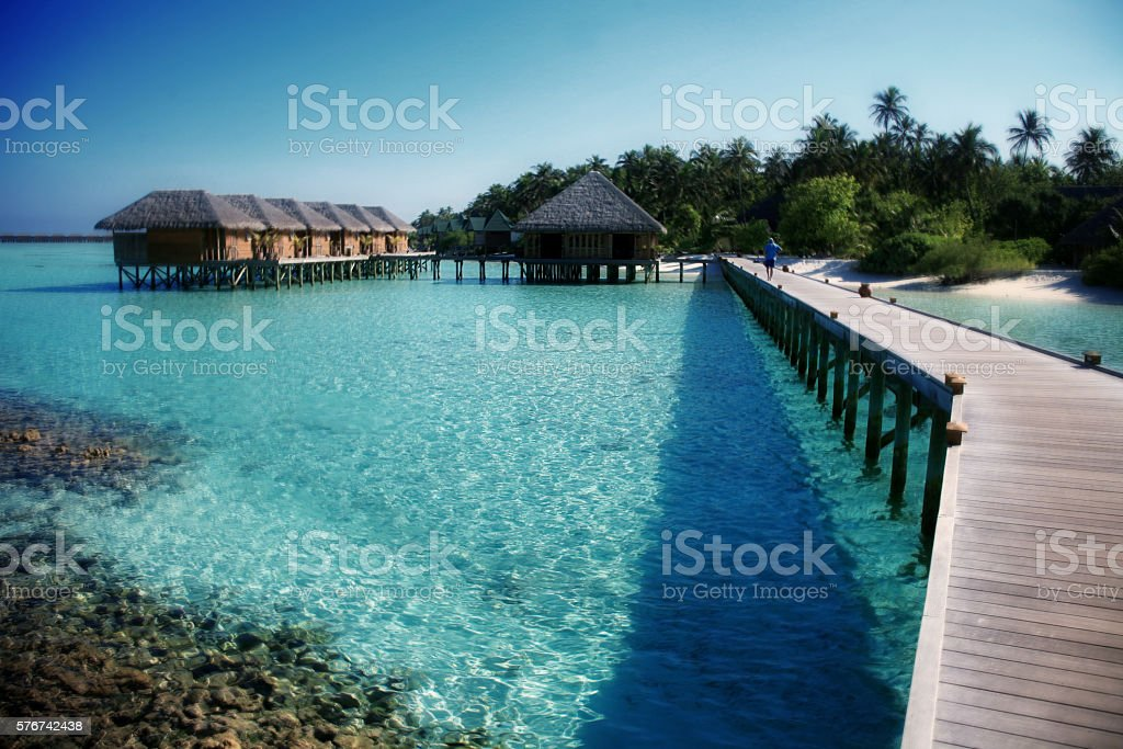 Pier and cottages in tropical paradise stock photo