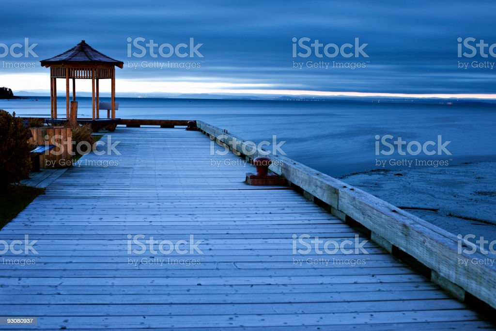 Pier and gazebo at sunrise stock photo