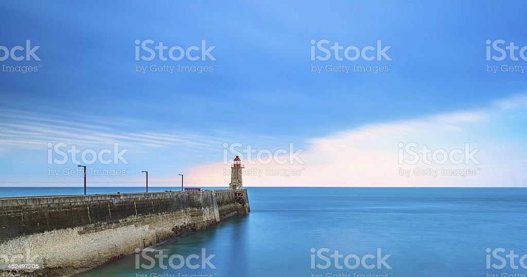 Pier and lighthouse on sunset, Fecamp harbor. Normandy France. stock photo