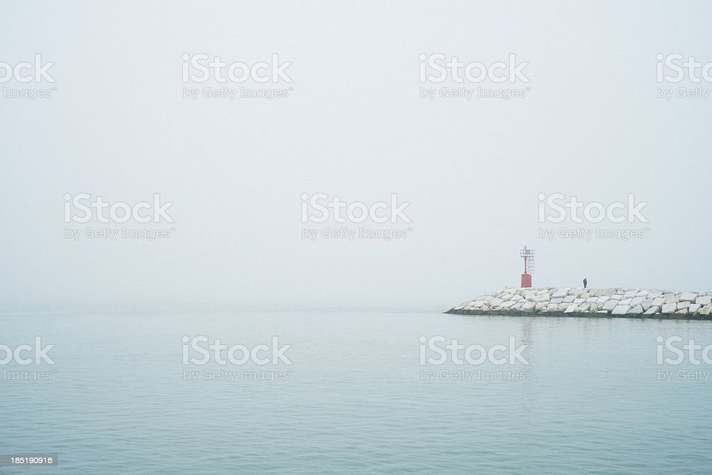 pier and lighthouse with fog royalty-free stock photo