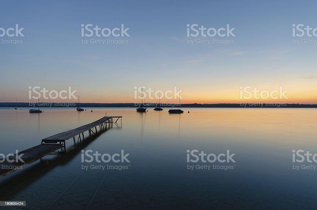 Pier and Sailboats at Lake Ammersee stock photo