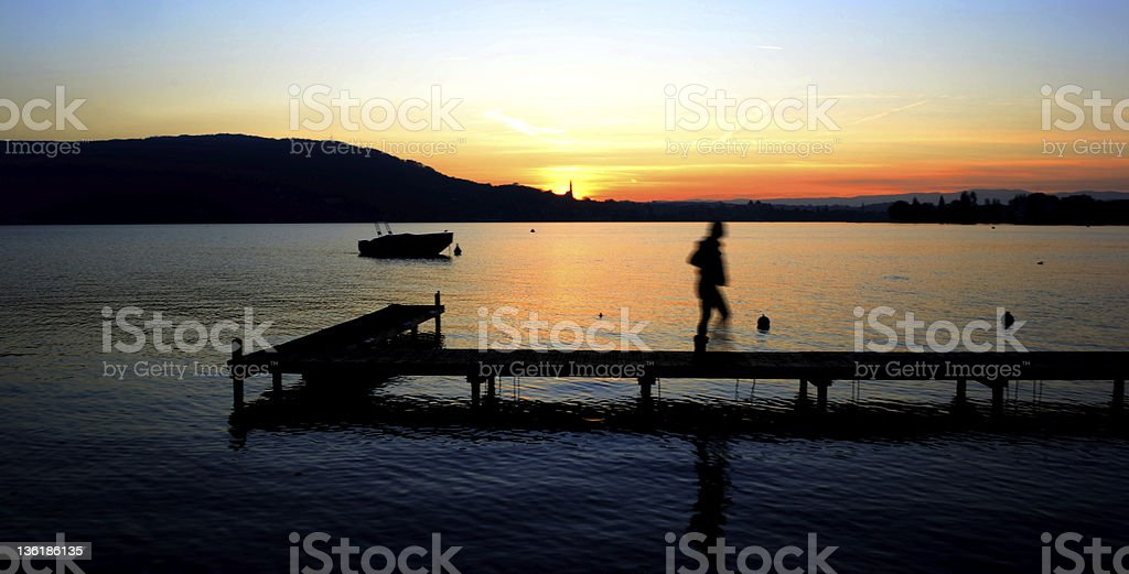 Pier and sunset in Annecy royalty-free stock photo