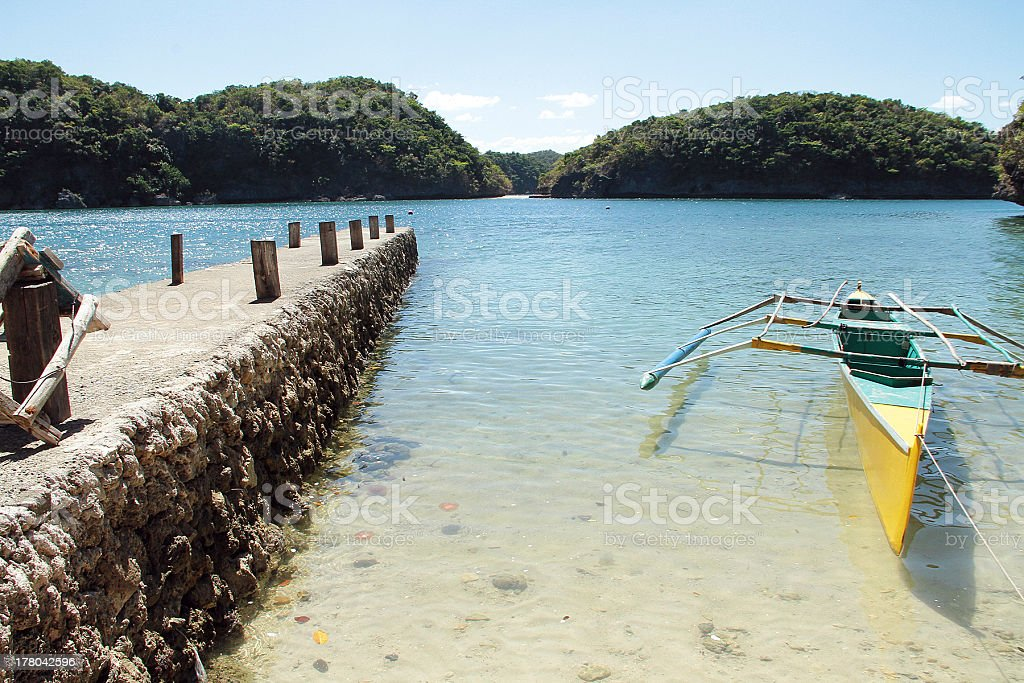 Pier and Yellow Boat in The Philippines royalty-free stock photo