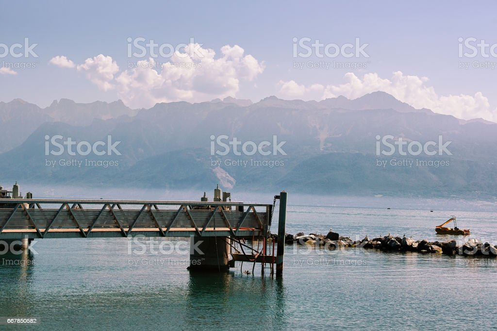 Pier at Lake Geneva promenade in Lausanne stock photo