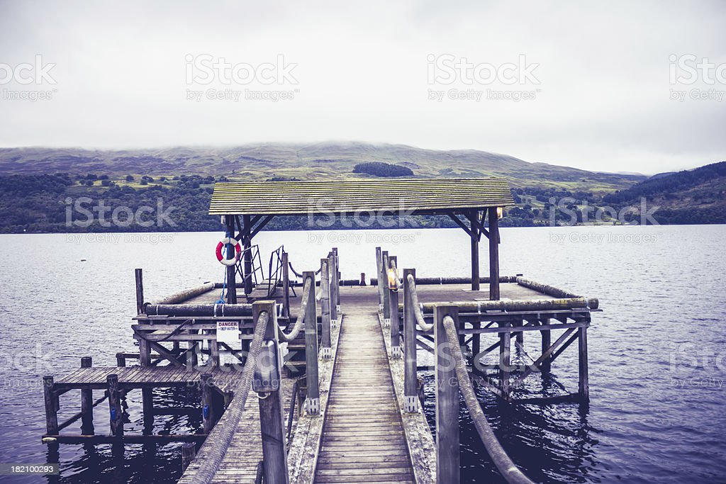 Pier at lake on gloomy day royalty-free stock photo