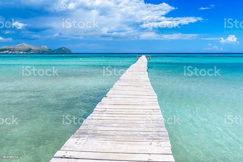 Pier at Playa Muro - Mallorca, balearic island of spain stock photo