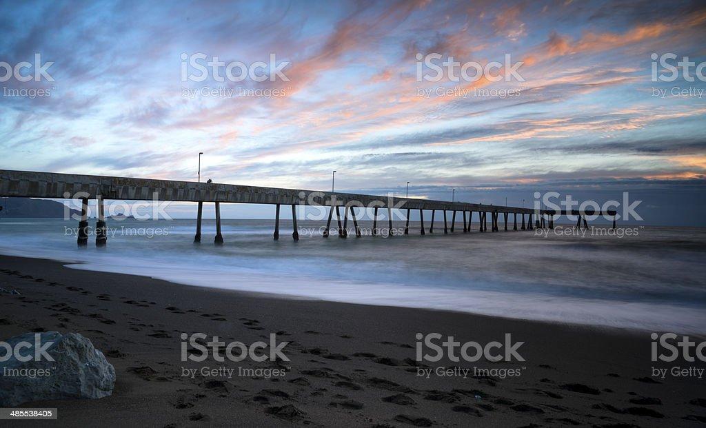 Pier at sunset stock photo
