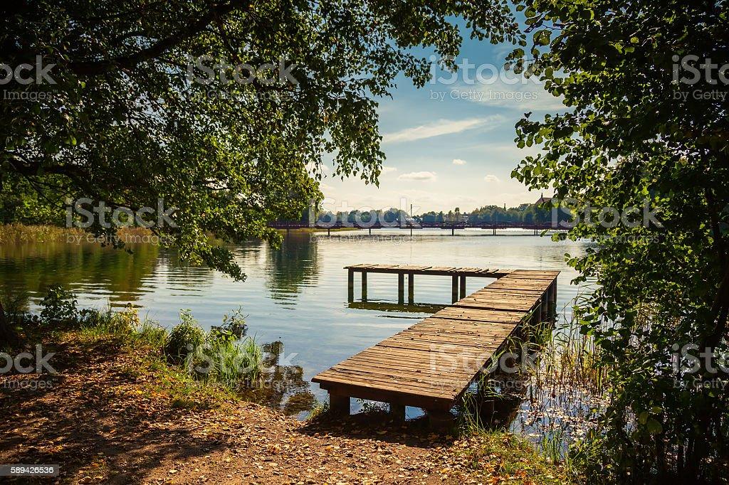 pier at the lake Galve in Trakai stock photo