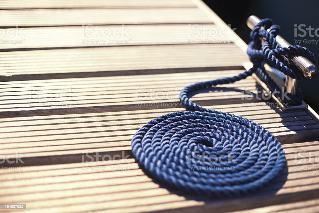 pier cleat and a mooring rope stock photo