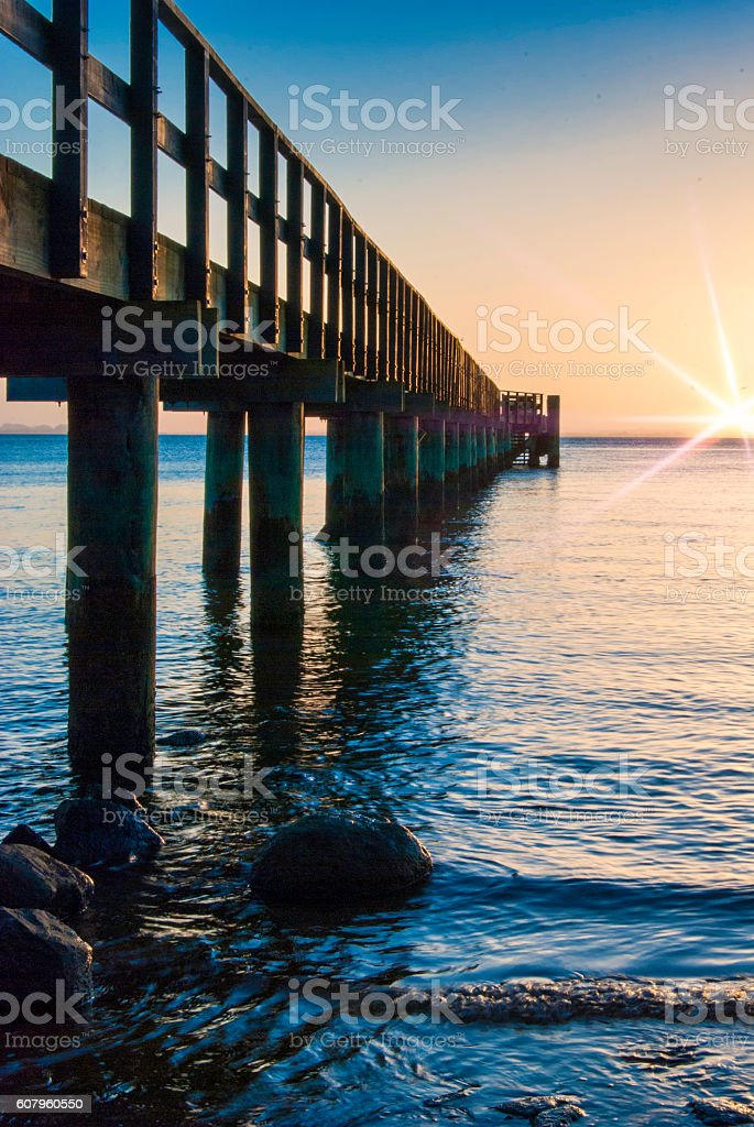 Pier closeup with flare stock photo