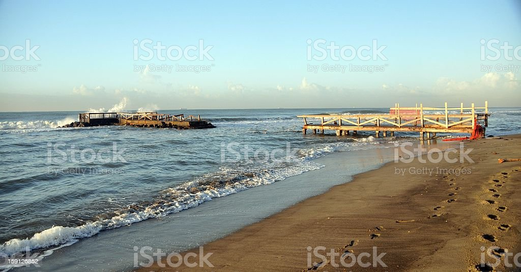 Pier destroyed in Ostia beach stock photo