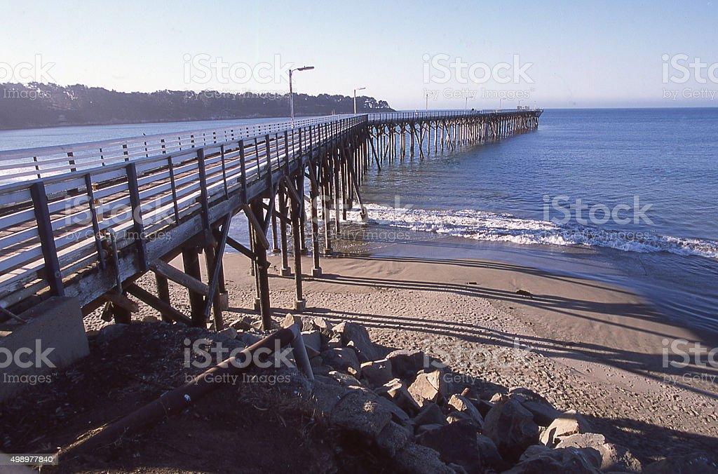 Pier extends into Pacific Ocean along Coast southern Oregon stock photo