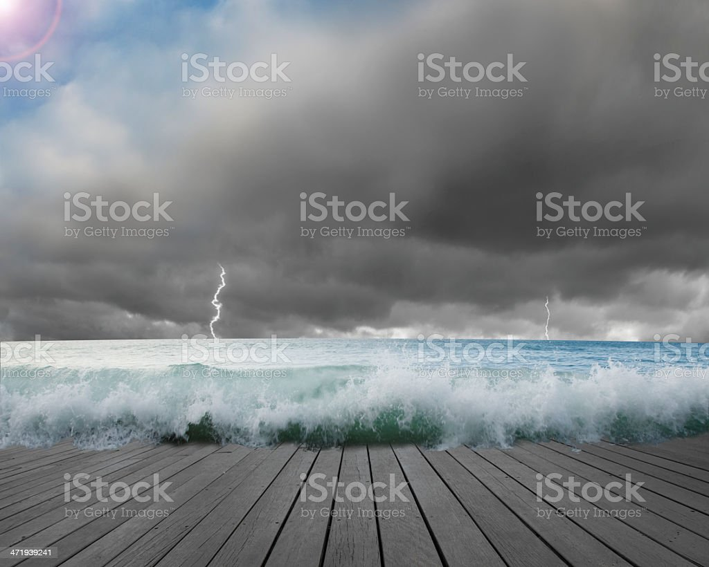 Pier flooded by waves with cludy sky, Lightning dangerous situation stock photo
