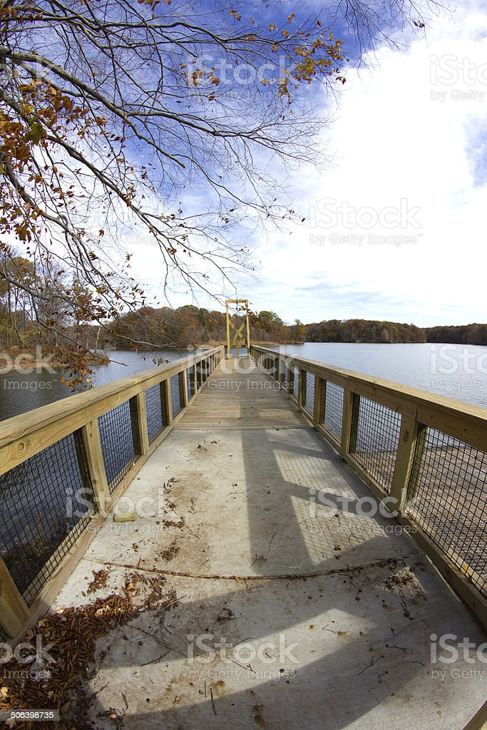 Pier Going out onto a Lake stock photo