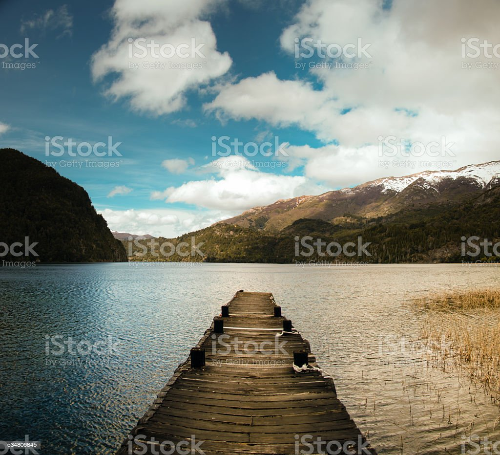 pier in a lake in esquel argentina patagonia stock photo