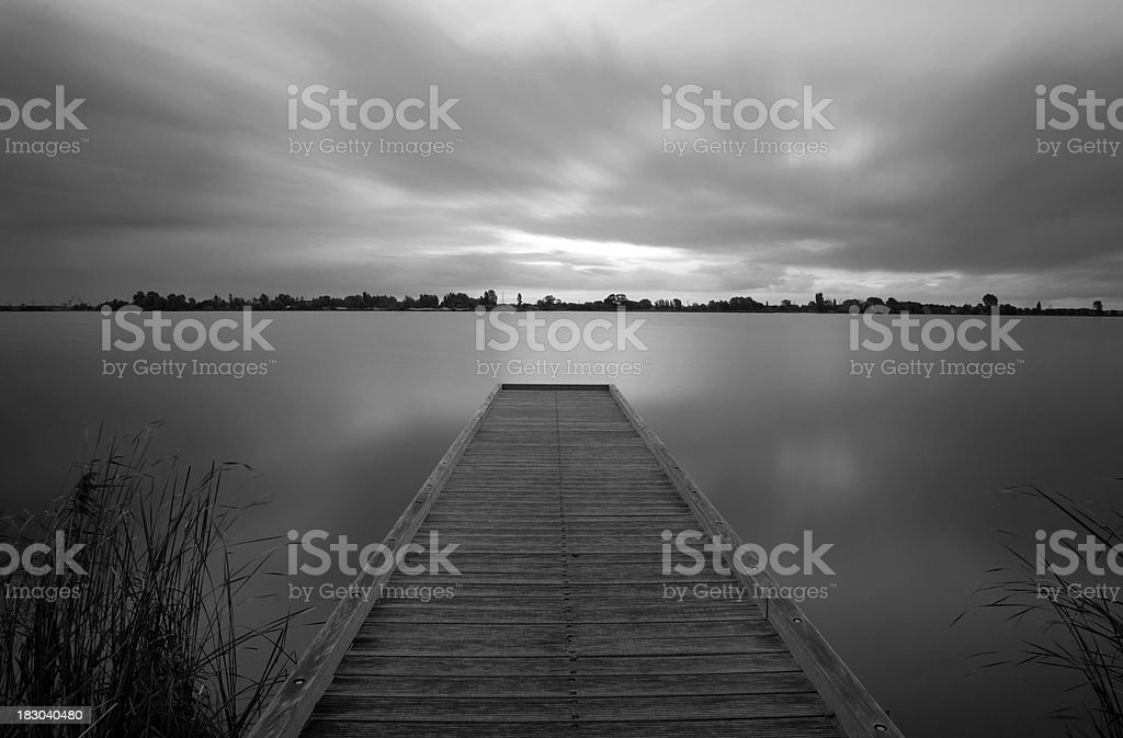 Pier in black and white royalty-free stock photo