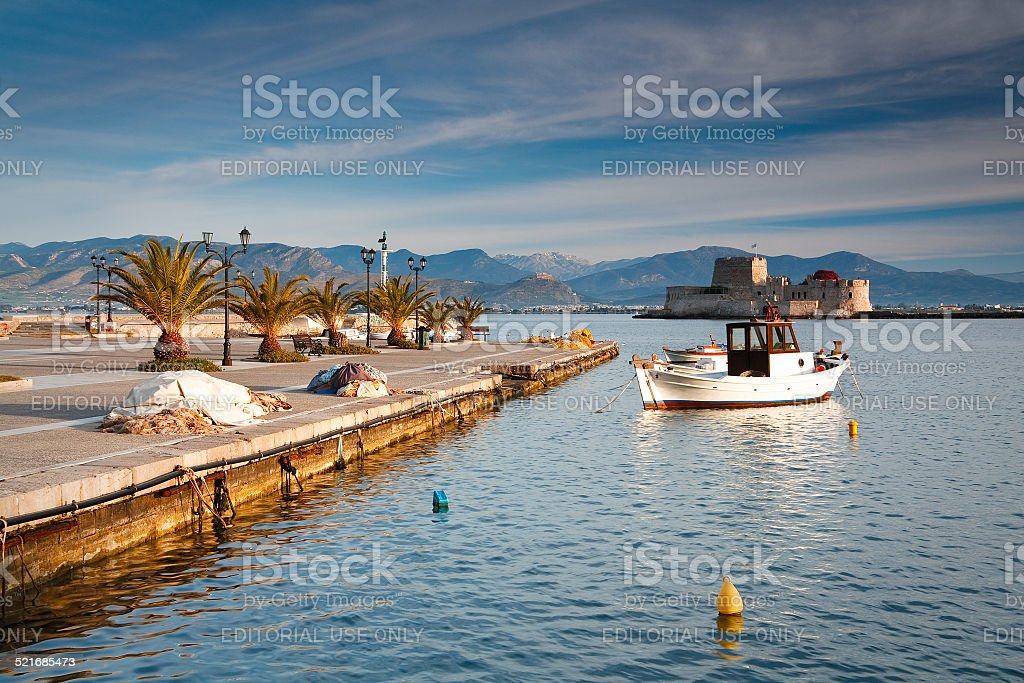 Pier in fishing harbour in Peloponnese, Greece. stock photo