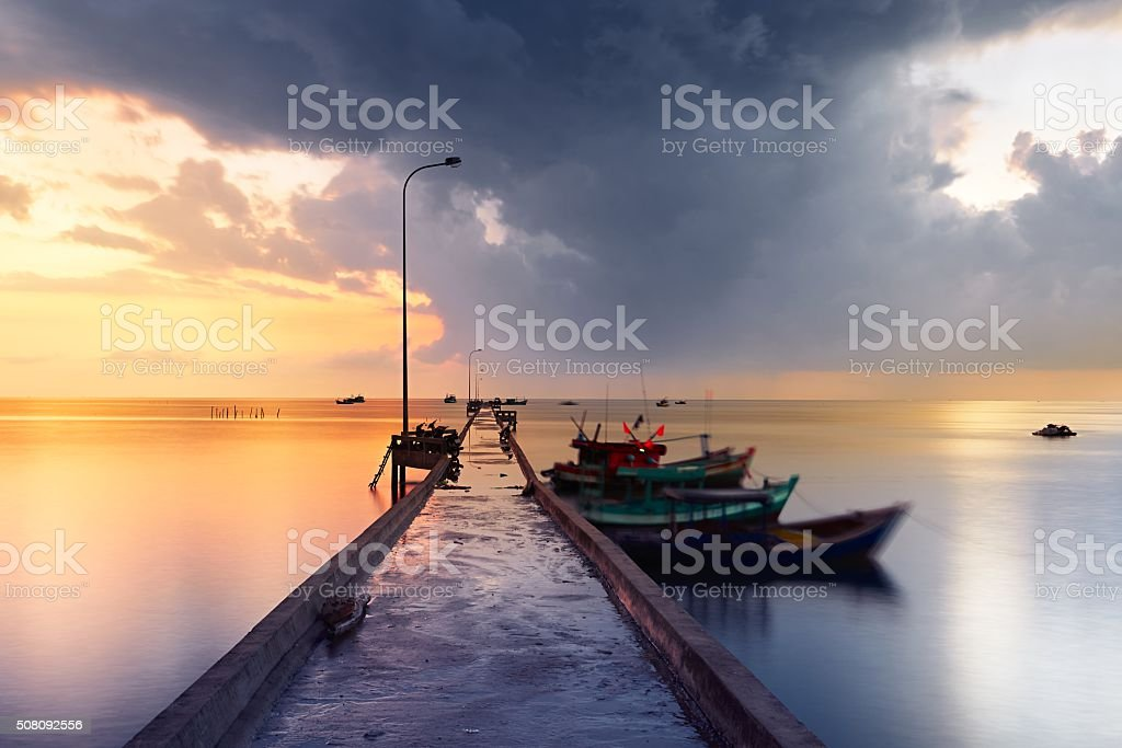 Pier in fishing village stock photo