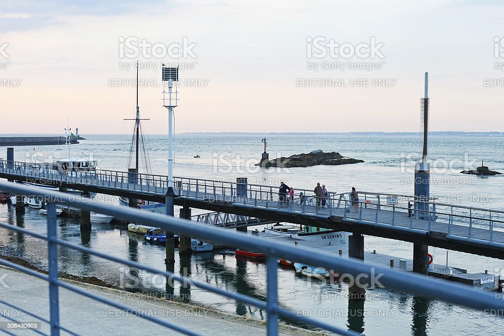 pier in Le Croisic town, France at sunset stock photo