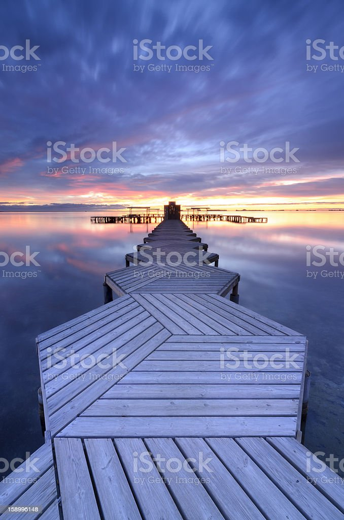 Pier in zigzag at twilight royalty-free stock photo