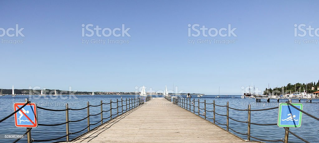 Pier into the sea stock photo