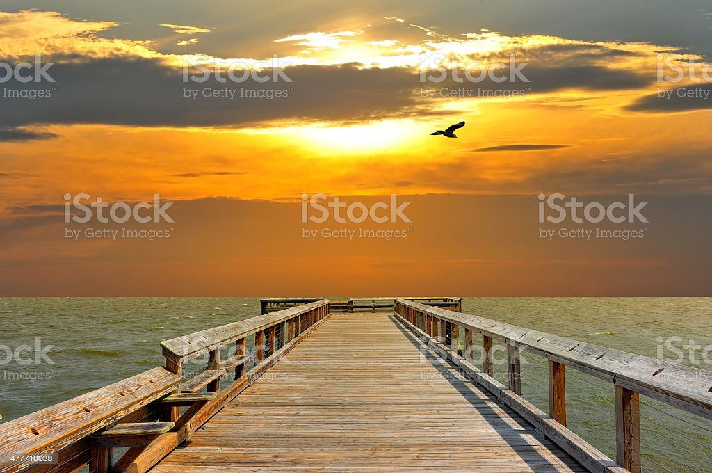 Pier into the sunset stock photo