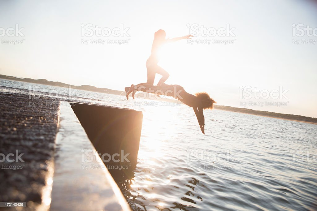 Pier Jumping stock photo