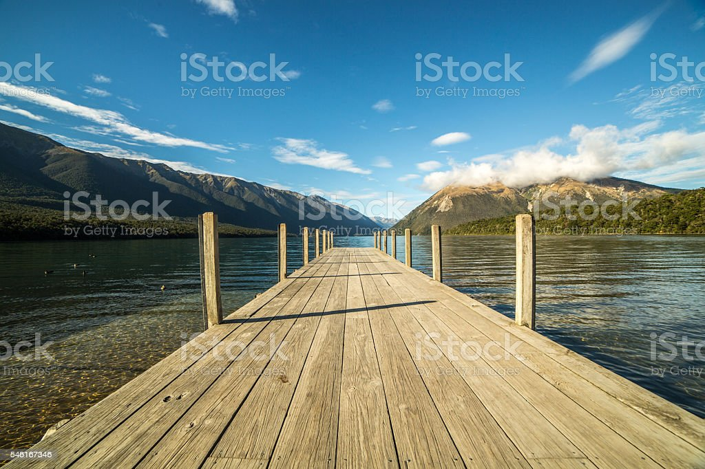 Pier lying on lake Rotoiti, New Zealand stock photo
